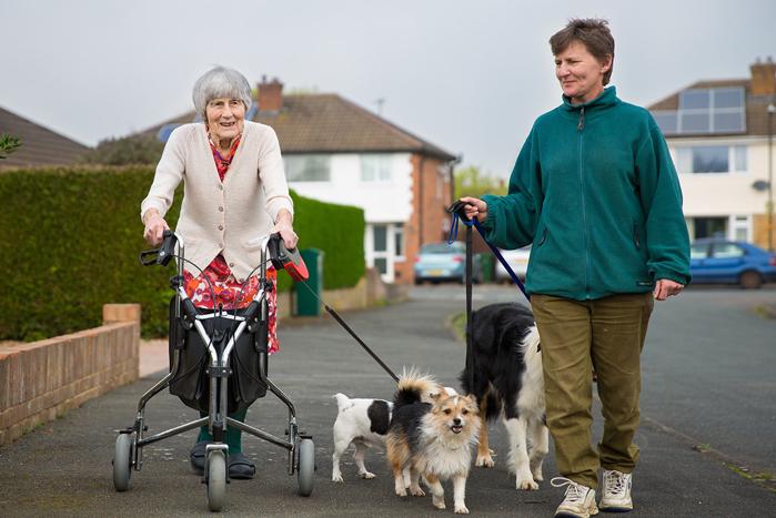 Two ladies walking dogs